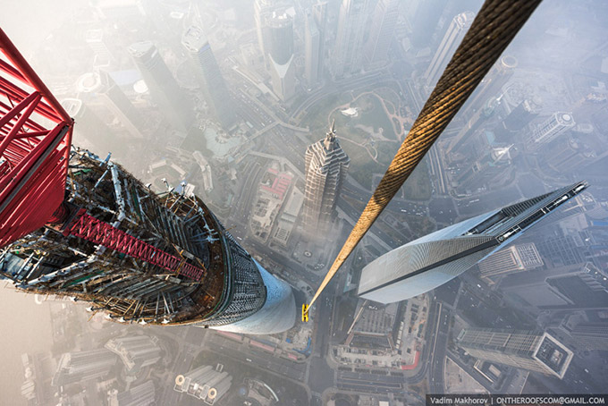 Stunning-photos-taken-by-the-two-Russian-daredevils-atop-Shanghai-2